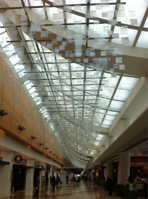 Inside the airport. These blinking glass squares fascinate me.