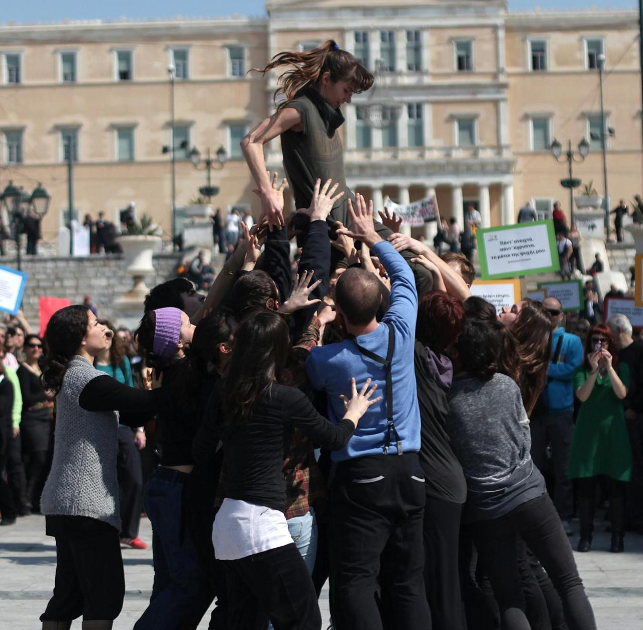 Dancers perform in front of the Greek Parliament during a protest by Greek poets, in central Athens on Wednesday, March 21, 2012. The anti-austerity protest was held on World Poetry Day. (Petros Giannakouris)