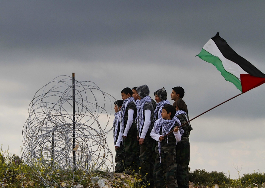 Today in Palestine: Land Day Palestinian boys look to the direction of the Lebanes-Israeli border during a Palestinian rally to mark Land Day, in the southern Lebanese village of Arnoun, Lebanon, on Friday March 30. More than 3,000 Lebanese and Palestinians gathered outside the Crusader-built Beaufort castle 9 miles from Israel. Lebanese security forces kept them from moving any closer to the border. Photo: Mohammad Zaatari/AP