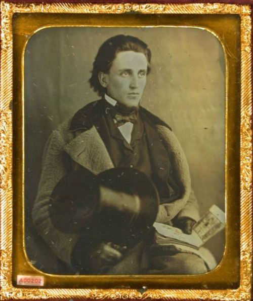 tuesday-johnson:  ca. 1850's, [daguerreotype portrait of a bank note salesman with open book, bank notes] via the Daguerrian Society, Matthew R. Isenburg Collection