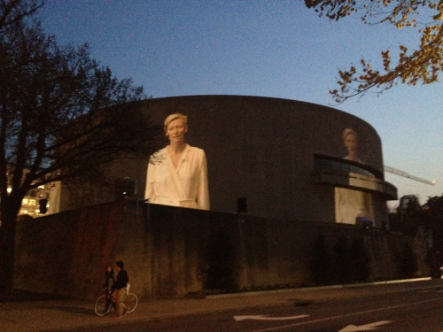 "DC public art at sunset. Doug Aitkin's ""SONG 1,"" a 360 degree projection onto the Hirshhorn Gallery, with sound. That's Tilda Swinton lip-syncing to ""I Only Have Eyes For You."""