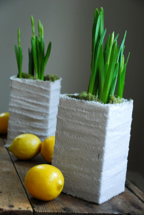 Why not wrap empty milk cartons in scrap fabric — and use as planters?  I know. I know. I've been on a spring planting kick lately. But this simple milk-carton-wrapped-in-fabric reuse idea from Camilla Fabbri of the Family Chic blog (mentioned previously here, here, and here) is worth sharing, especially this week, as some folks are looking at decor sorts of ideas for Easter.