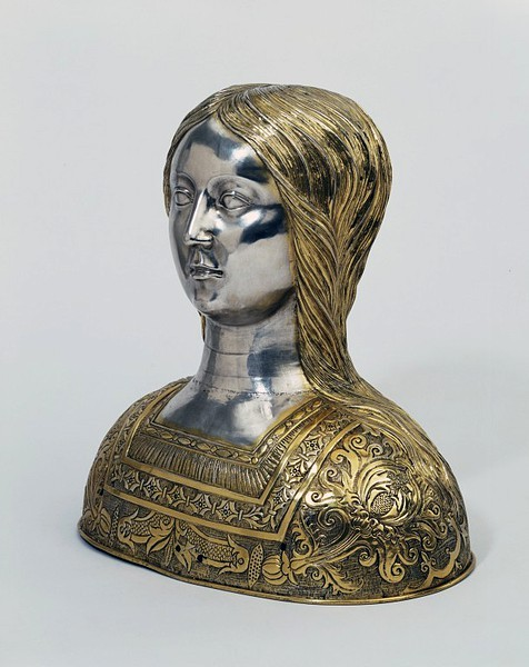 Reliquary from Spain, ca. 1525. V&A Museum, London:  This empty reliquary portrays a young girl in a brocaded dress with a fashionable square-cut bodice. Her identity is unknown, but she probably represents a virgin martyr, perhaps St Ursula who, according to legend, was martyred with 11,000 virgins. The reliquary may originally have held a relic of her head.  Find another Ursula virgin reliquary here.