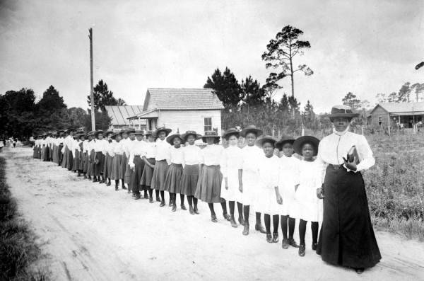 coolchicksfromhistory:  Mary McLeod Bethune with a line of girls from her school in Daytona Beach, Florida circa 1905.  The school eventually developed into Bethune-Cookman University.