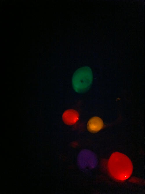 Playing in the dark with glow-in-the-dark balloons.  Frickin' cool!