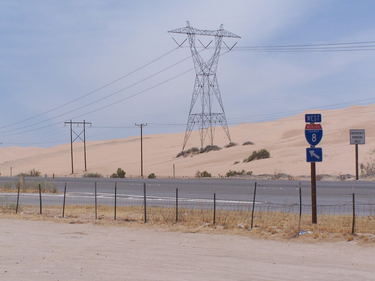 "The southern limit of California. The electrical tower is in Mexico, the road is in California. The fence on the south side of the highway is actually ""on"" the border. There are hundreds of border patrol officers in every state bordering Mexico. There are volunteers in Arizona, who fly over the desert north of the border, carrying water and medical supplies to rescue people running the border, who get into trouble in the heat. It's a crazy place. The temperature when I took this photo was 112 degrees Fahrenheit/44 degrees Celsius. It was a cool day, as the summer heat goes there."
