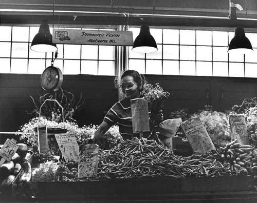 Vegetable and flower seller and stall, Pike Place Market, Seattle, Washington 1970