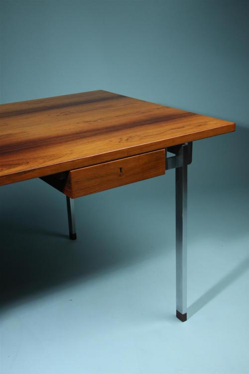 Designed by Hans Wegner for Andreas Tuck, Denmark. 1960's.Brazilian rosewood and matt steel legs. About Modernity: Modernity is a leading gallery in Stockholm, Sweden, dealing in 20th century design. We specialize in Scandinavian Design: furniture, ceramics, glass, lighting and jewellery. Our range consists of both well known classics and rare pieces by artists such as Hans Wegner, Arne Jacobsen, Alvar Aalto, Axel Salto, Berndt Friberg, to name but a few. The emphasis is on post-war design. Modernity supplies pieces to international collectors and museums. Our busy central showroom has also become a meeting place for anyone interested in 20th century design.