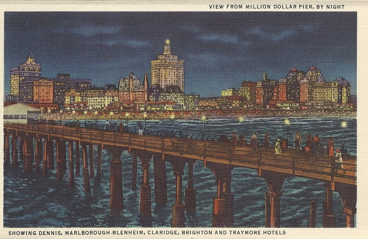 View from million dollar pier, by night Showing Dennis, Marlborough-Blenheim, Claridge, Brighton, and Traymore hotels