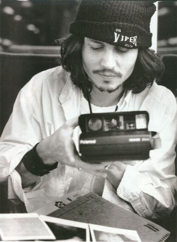 Johnny Depp with a Polaroid.