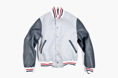 Thom Browne Summer Letterman Jacket New from Thom Browne comes the Summer Letterman Jacket from the American designer's Spring/Summer 2012 collection. Fitting in perfectly with the aesthetic of pieces like the Wool Jacket and Sport Jacket from the line, the Letterman Jacket utilizes red, white and blue striped ribbing at the hem, collar and cuffs alongside dark grey leather sleeves and slash pocket detailing. The piece is now available now from retailers like Roden Gray, priced at for $1,280 USD.