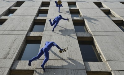 Walls and Trumpets by Ofra Zimbalista Sculptures of blue-clad men carrying musical instruments hang from the Maya House building in Borough High Street, South London, United Kingdom (Spotted on Hungeree)