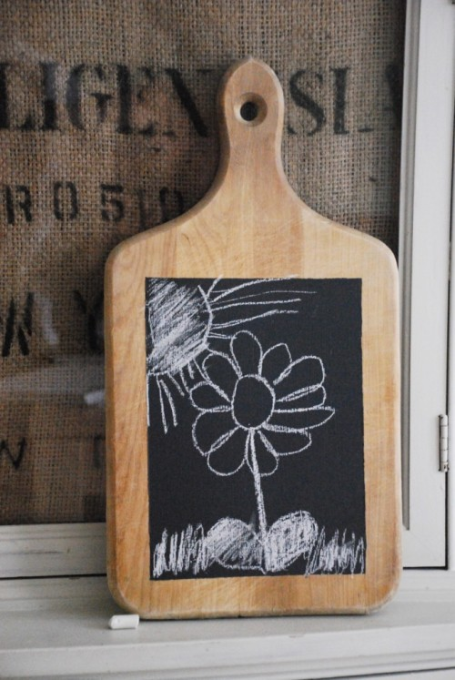DIY Cutting Board Chalkboard. Lots of old, beat up wooden cutting boards out there. You could use lots of different color chalkboard paints and it moveable. Like the idea of this better than a lot of chalkboard ideas. From Family Chic here.