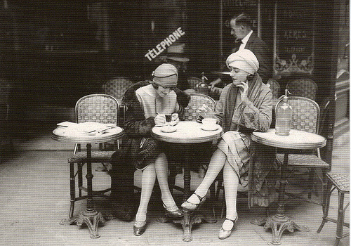 Stylish women at a Parisian cafe (1920s)