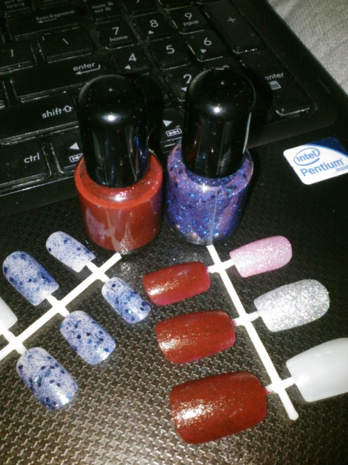 See these polishes?  The red (with black glitter), and the blue glitter?  THEY'RE SCENTED. Strawberry and Blueberry. AND I MADE THEM.  Coming soon to the etsy. What other scents might you be interested in for a scented polish?