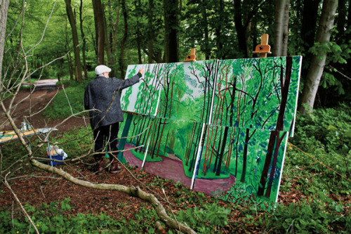 (via David Hockney Returns Home) David Hockney, painting outside.
