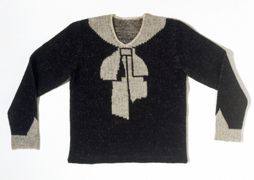 This cute hand-knitted sweater with a trompe-l'oeil bow was the piece that launched Elsa Schiaparelli's fashion career. She made the sweater for herself in 1927 and soon afterward wore it to a society luncheon where it caused quite the sensation. She soon received numerous requests from other attendees to make copies of the sweater available for purchase. Her business soon grew enough for her to open a salon. The rest is fashion history.