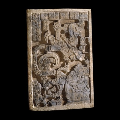 "omgthatartifact:  Yaxchilán Lentil Maya, 600-900 AD The British Museum ""This limestone lintel is one of a series of three panels from Structure 23 at Yaxchilán and was originally set above the central doorway. The building is dedicated to Shield Jaguar II's wife, Lady K'ab'al Xook. It has particular significance since this was the first building to be constructed after a gap of over 150 years in the dynastic history of the city. It seems that the series of lintels was intended to convey a special message of the re-foundation of the site. Indeed, Shield Jaguar's building programme throughout the city may have been an attempt to reinforce his lineage and his right to rulership. Lady Xook, on the bottom right of the panel, is in the hallucinatory stage of the bloodletting ritual. She conjures before her a vision of a Teotihuacan serpent. Some scholars suggest that the serpent on this lintel, and elsewhere, are depictions of an ancestral spirit or founder of the kingdom. The identity of the figure coming out of the serpent's jaws is ambiguous. The inscription names the protagonist as Shield Jaguar II. The ritual is conducted to commemorate the accession of Shield Jaguar II to the throne. The inscription is reversed, as if to be read in a mirror. This is not common and its true significance is not known."""