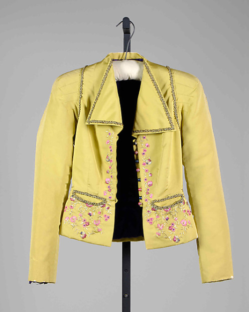 A brightly colored, embroidered evening jacket from Schiaparelli's Fall-Winter 1938-1939 collection. I love the pintucks on the shoulders.