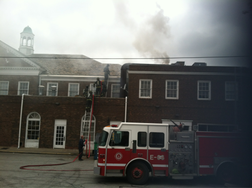 "FIRE on FIRE- The Cleveland Fire Department rush to the top of ""Fire Food and Drink"" March 31 to extinguish a fire that began at 4:40 p.m and lasted 30 minutes. The flames covered both the top and bottom portion of the establishment, damaging one of three offices located upstairs. There was also damage to kitchen equipment located downstairs. The restaurant located at 13224 Shaker Square may have to close for a month for repairs. The cause of the fire hasn't yet been determined."