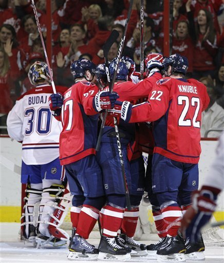 The Washington Capitals celebrate after center Jay Beagle scored a goal against Montreal Canadiens goalie Peter Budaj (30) during the first period of an NHL hockey game on Saturday, March 31, 2012 in Washington.