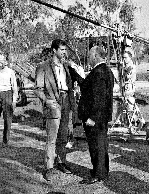 Alfred Hitchcock and Anthony Perkins confer on the set of Psycho (1960).