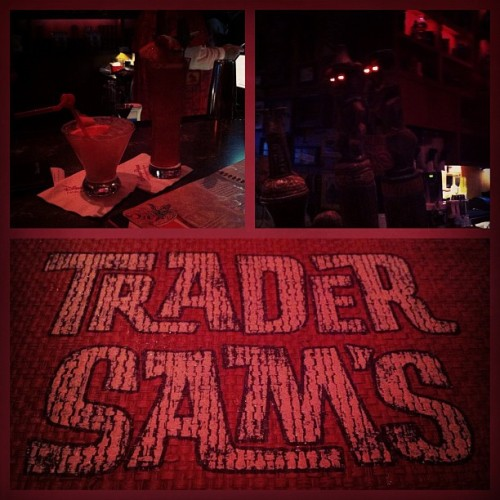 Getting into trouble. (Taken with Instagram at Trader Sam's Bar)