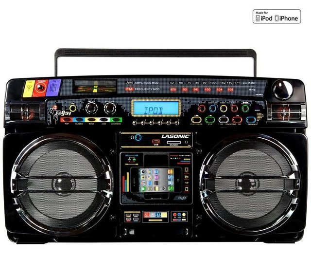 Lasonic i931X Ghetto Blaster with iPod/iPhone Dock  Features: Supported USB flash disk and SD/MMC card to playback MP3 files Enjoy your music from iPod without earphone iPod/IPhone control and charging Watch video on your TV if using iPod Video Dual Band Radio Tuner function (AM/FM) FM 20 preset stations and AM 20 preset stations Show RBDS (Radio Broadcast Data System) text on LCD display Alarm to wake up and sleep function Accurately real time clock display Separate bass and treble controls Powerful speaker sound system (12W x 2) EQ adjustment Volume level indicator AUX IN for extension function Headphone jack output Microphone input and volume/echo adjustment Full function remote control Power Supply : AC / DC iPod/iPhone is not included  (vía Amazon)