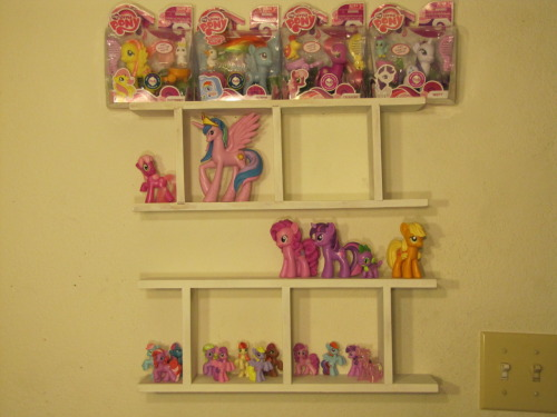 My Little Pony Friendship is Magic toy collection so far. The teeny blind bag ponies and fully sculpted ones are my favorites. There are still a few that need to go up. The shelves are a yard sale rescue from way back. -Topknot
