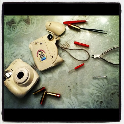 Operating on my camera Stephen. Hope it survives :'( #polaroid #camera #photography #operation #instax (Taken with instagram)