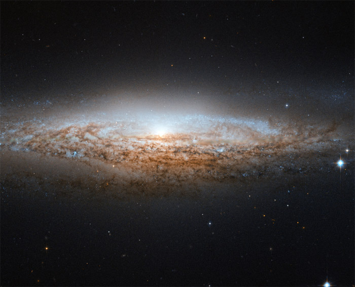 "A Monday morning astronomy fix from discoverynews:  Hubble Spies 'UFO' Galaxy Good photography is not just about timing. It also depends on good positioning. Case in point? This view of a spiral galaxy, which is fortuitously positioned edge-on relative to the view from the Earth-orbiting Hubble Space Telescope. The galaxy, officially known as NGC 2683, was nicknamed the ""UFO Galaxy"" by astronomers at the Astronaut Memorial Planetarium and Observatory in Cocoa, Fla. keep reading  ~reblogged by Trent Gilliss, senior editor"