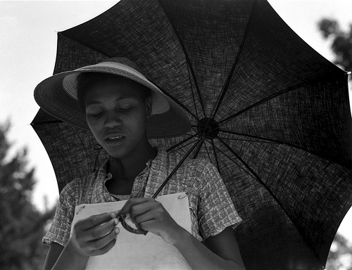 "trialsandarchives:Dorothea Lange: Girl with umbrella (""Louisiana negress""), Louisiana, 1937 (by trialsanderrors)"