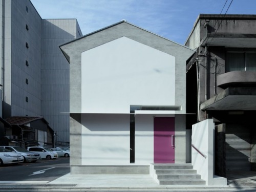 "The House with the Pink Door by EASTERN design office ""This house has been modeled after the shape of a keyhole with a narrow window framing the door"""