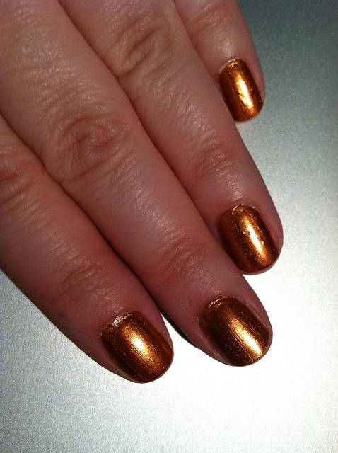 Zoya - Penny on Flickr. This is my second Zoya color, but if I can find some more at good prices I think I'm definitely going to buy some more. I really liked how smooth this went on, and how after two coats the color was solid. The brush was also short and manageable. Plus the color was really shiny.