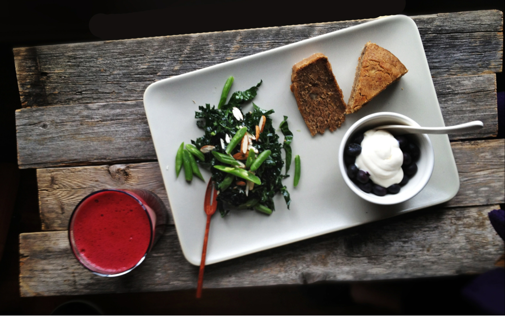 At home Sunday brunch:  raw kale salad, homemade banana bread, warm blueberries and fresh-made juice.  I love brunch!
