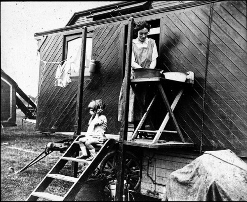 Woman washing outside caravan by Tyne & Wear Archives & Museums on Flickr.Look at the photo. Consider what has has just happened here, or what is about to happen here. Who has been here? Who will come here and and what will they do? What kinds of interactions can you imagine? Write one leaf about these or other things that occur to you upon looking at the picture. Do not allow yourself to be limited by what you see. Go.| Write One Leaf + about + ask + random + facebook + twitter | sponsors + You Are a Dog [ Kindle | Google | iBookstore ]