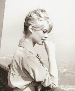 billowy:  Brigitte Bardot at the top of the Eiffel Tower, Paris, 1950s