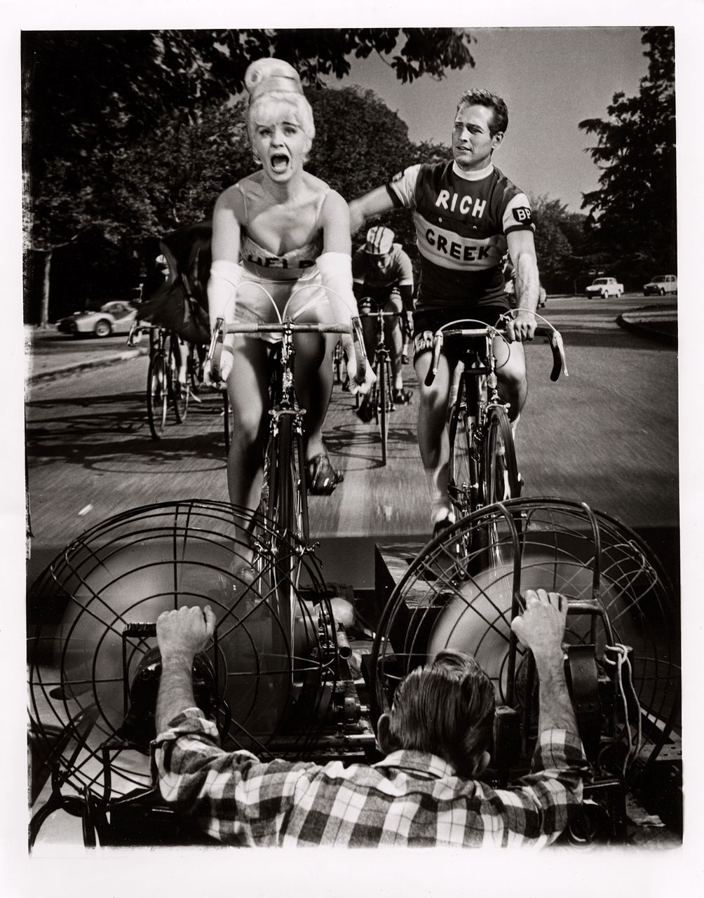 ridesabike:  Joanne Woodward and Paul Newman ride bikes.