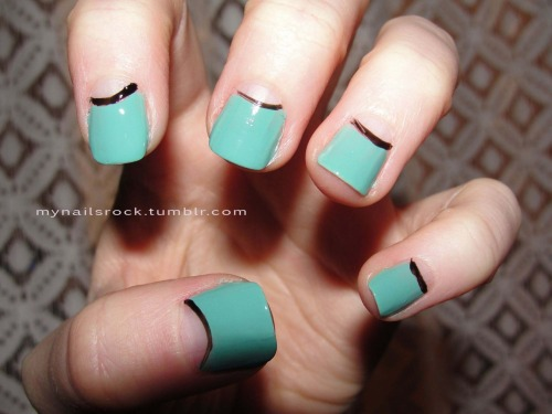 Minty empty moons.  Here are some mint green nails with empty moons and a black accent. Polish used: Zoya Wednesday