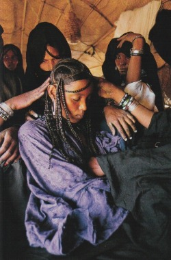 haygirlhey:  National Geographic- February 1998 The bride sits silent as female relatives and artisans attend to her.