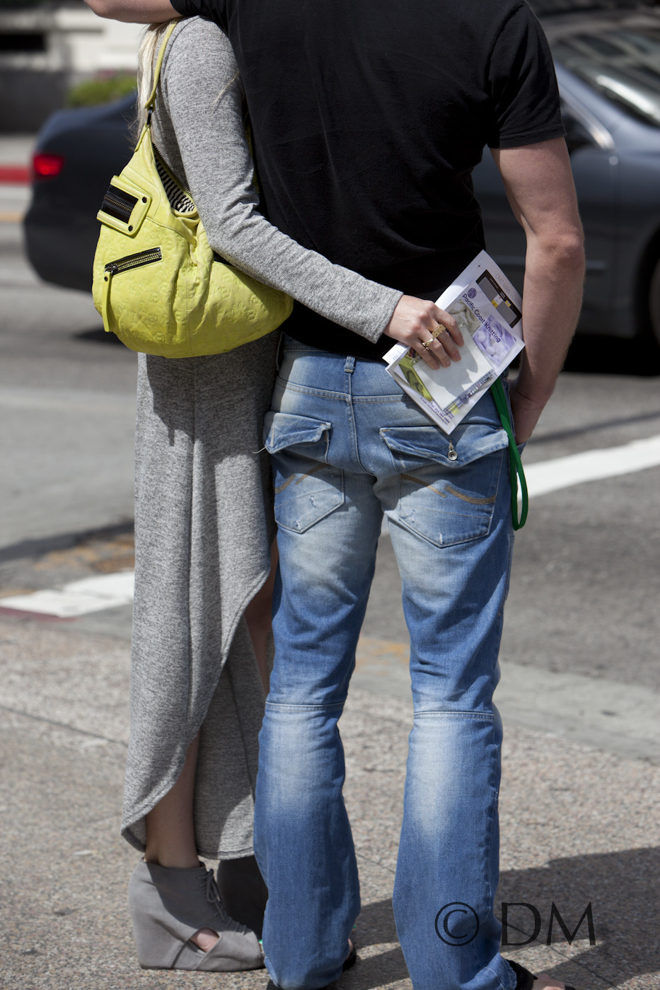 Hugging her man, and her L.A.M.B. neon bag.