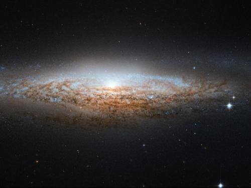 Hubble Spies a Spiral Galaxy Edge-on Image Credit: ESA/Hubble & NASA