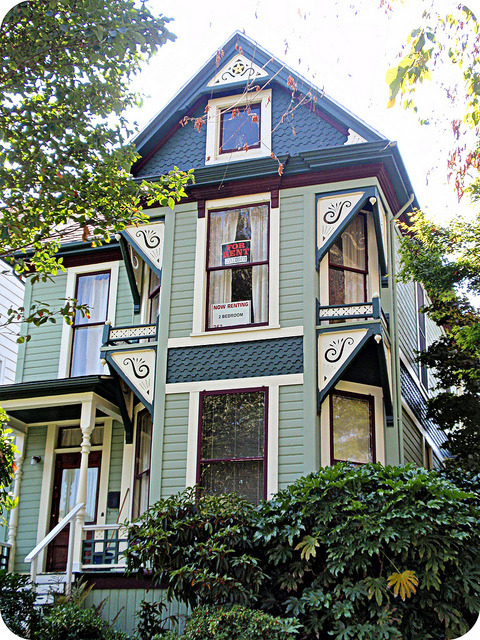 Green Queen Anne Victorian house, front view by eg2006 on Flickr.