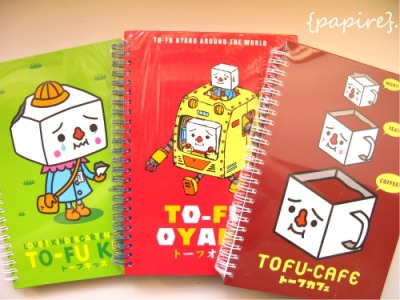 Tofu Oyako Hard Cover Notebook  Design: (From Left) Tofu Kid | Tofu Robot | Tofu Cafe  Designed By: DEVILROBOTS Produced and Manufactured By: Play Imaginative Made In Japan Type: Notebook Dimensions: 21 * 16cm 1.3cm Thick Hard Cover Ring Bound Notebook TOFU-OYAKO!!!  Super Limited Quantity. This is a one-off collection. Once gone, well, that's that. Grab Quick!   SGD$5.00 each  Details: