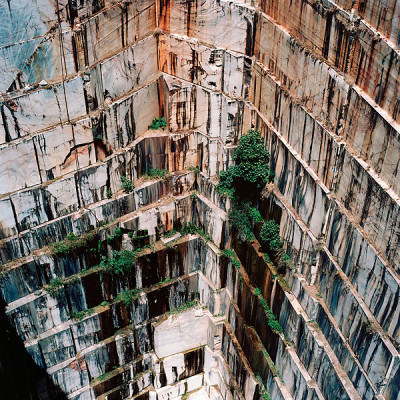 anthropologie:  525 feet below the earth's surface. That's how far photographer Tito Mouraz journeyed into the rock quarries of Portugal to document realms forever transformed by mining. He spent two years touring the layered landscapes, capturing them as spaces of beauty and wonder rather than excavation.  Via: Fast Co Design  earth's beauty never fails to amaze me… Wow.
