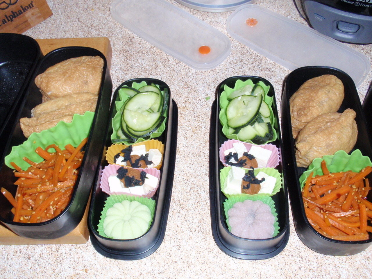 Though I need to work on my food photography, here are the bentos I made for myself and my husband for today. Inarizushi filled with rice and mushrooms, carrot kinpira, quick pickles, miso and tofu for soup, and mochis! Yum.
