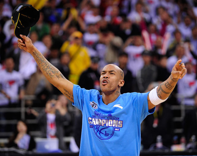Former NBA superstar Stephon Marbury celebrates after his team, the Beijing Ducks, won their first-ever Chinese championship in Beijing on Friday. Marbury scored 41 points in beating the defending champion Guangdong Tigers 124-121. (STR/AFP/Getty Images) GALLERY: Stephon Marbury in China | Rare Photos of MarburyGRAHAM: Marbury finds redemption playing basketball in China