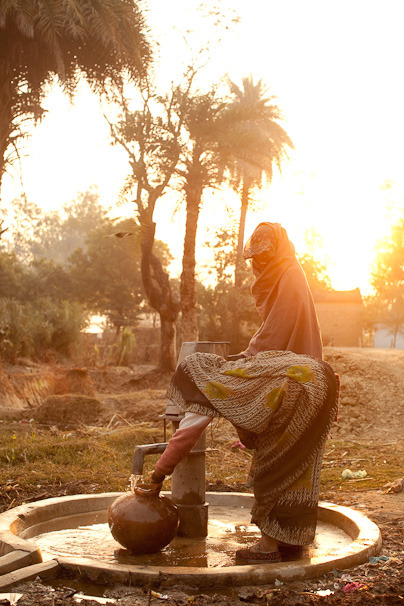 Two women getting water for their families in a rural town in India.  Learn how sustainable solutions are helping to keep their families healthy with access to clean water: www.theadventureproject.org