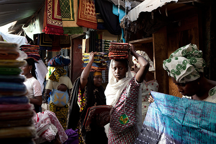 Cloth sellers wait for customers at the Grand Market. Many sellers say business is suffering as worried residents in the capital, Bamako, hold off from purchasing non-essential items a week after a military coup threw the country into turmoil, Bamako, Mali, April 1, 2012. [Credit : Rebecca Blackwell/AP]