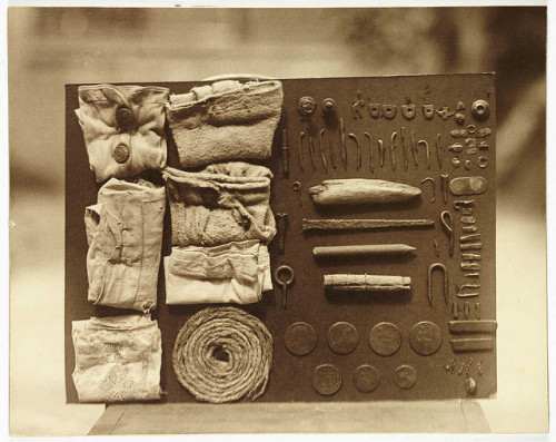 Contents of an Ostrich's stomach  FW Bond (died 5 May 1942) Collection of National Media Museum Frederick Willam Bond was photographer at the Zoological Society of London. Amongst more conventional photographs of the inhabitants of London Zoo, he also photographed objects retrieved from an ostrich's stomach after its death. Details of what it swallowed are written on the back of the print. Somehow, during its lifetime, the poor bird managed to ingest a lace handkerchief, a buttoned glove, a length of rope, a plain handkerchief (probably a man's), assorted copper coins, metal tacks, staples and hooks, and a four-inch nail - a step too far, and the cause of death.
